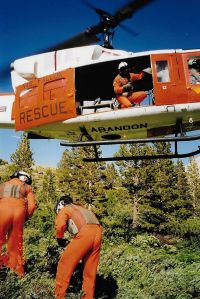 dunderberg-peak-bright-orange-hover-with-crewmen-on-ground